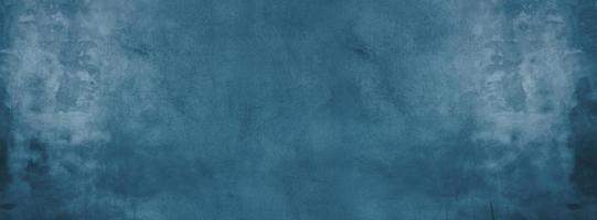 Dark blue cement or concrete wall for background or texture photo