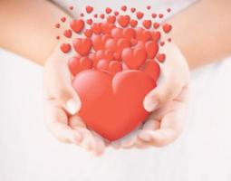 A hand holding hearts photo