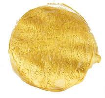 Textura de círculo de pintura dorada aislado sobre un fondo blanco. foto