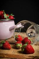 Strawberries in a bowl and glass photo