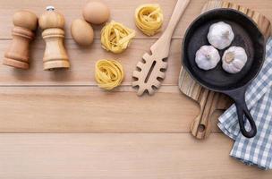 Pasta ingredients with skillet