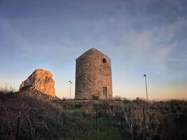Old abandoned windmill in Calpe photo