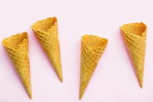 Waffle cones on a pink background