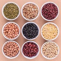 Bowls of beans and lentils photo