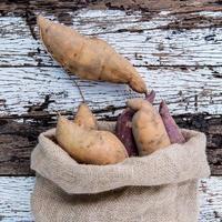 Sweet potatoes in a sack photo