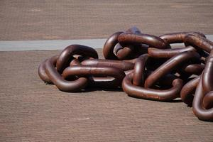 Old brown chain links in the seaport photo