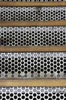 Metal stairs with holes photo