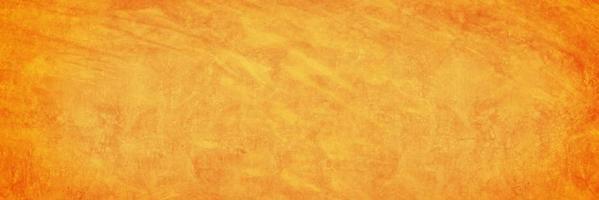 cemento naranja o muro de hormigón para el fondo o la textura foto