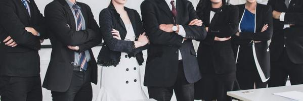 Group of business people standing with arms crossed