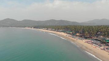 Long sand stretch of Palolem beach. Tranquil turquoise sea waters. Goa, India. video