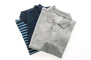 Fashion polo shirts on white background photo