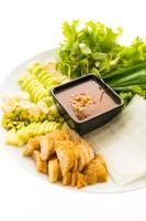 Vietnamese Pork Sausage and salad on a white plate photo