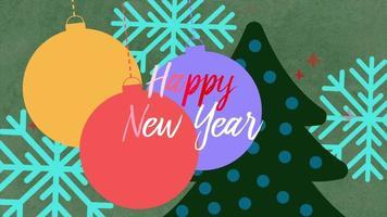 geanimeerde tekst van het close-up gelukkige nieuwe jaar en witte sneeuwvlokken met boom en ballen op vakantieachtergrond video