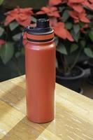 Red travel thermos photo
