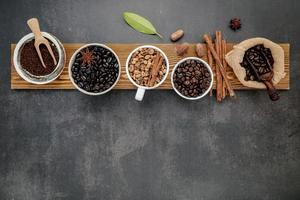 Mix of roasted coffee beans on a wooden board