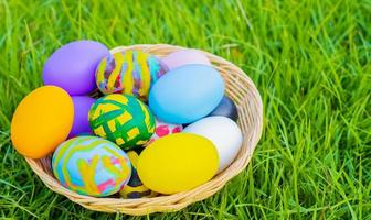 Beautiful multi-colored Easter eggs on the grass photo