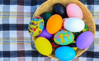 Beautiful colorful Easter eggs in a basket for Easter day photo