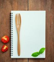 Notebook mock-up with tomatoes and basil