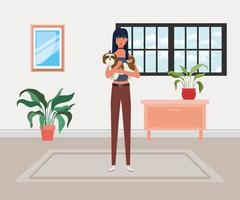 young woman lifting cute dog in house vector