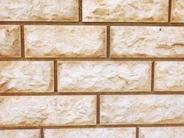 Pared de ladrillo de cemento o hormigón para el fondo o la textura foto