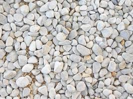 Cama de piedras grises o guijarros de fondo o textura foto