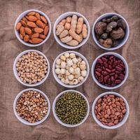 Top view of beans and lentils in bowls photo