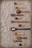 Wooden spoons of beans and lentils photo