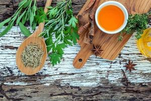 Cooking oil and herbs photo
