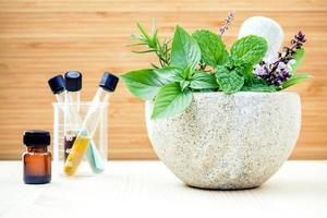 Fresh herbs and essential oils photo