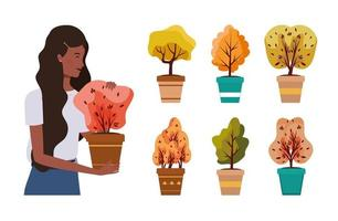 afro woman with autumn plants in ceramic pots vector