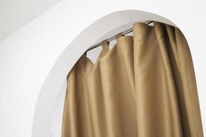 Curtain hanging on arched doorway