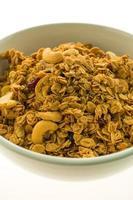 Granola in a white bowl photo