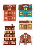 Paquete de fachadas de casas con nieve. vector