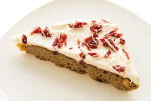 Cranberry cake on white plate photo