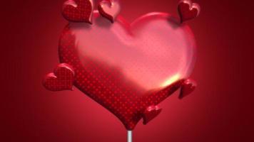 Animation closeup motion gros bonbons coeur romantique et petits coeurs sur fond brillant rouge Saint Valentin