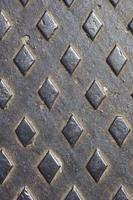 Texture of rusty metal floor plate with bumped pattern