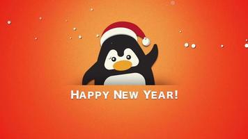 primer plano animado feliz año nuevo texto, divertido pingüino saludando sobre fondo naranja video