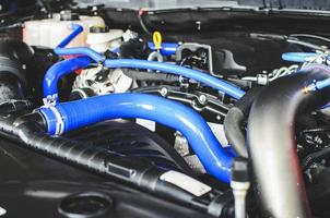 Tubes in car engine photo
