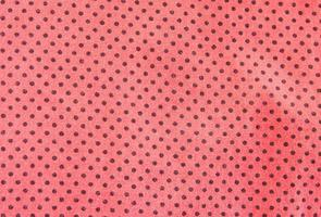 Red and black polka dot background photo