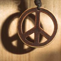 Symbol of peace love and not war of wood with shadow photo