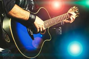 Guitar player during a show photo
