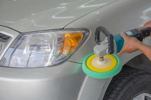 Person buffing wax on car
