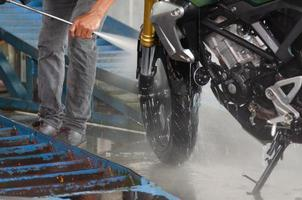 Person washing a motorcycle photo