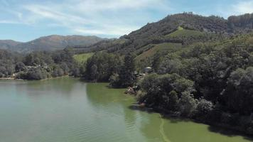 Footage flying over a lake in a vast valley of the Western Ghats mountain range near Munnar, India video