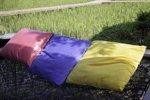 Colorful pillows on a hammock photo