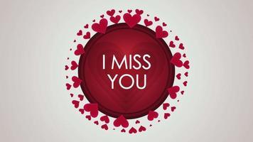 closeup animado, sinto sua falta, texto e movimento românticos pequenos corações vermelhos no fundo do dia dos namorados video