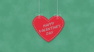 animierte Nahaufnahme glücklich Valentinstag Text und Bewegung romantisches großes rotes Herz auf Valentinstag Hintergrund