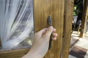 Woman's hand on the door photo
