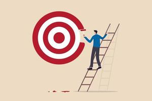 ambitious businessman on ladder using paint roller to paint a big target vector
