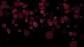 rörelse och flyga röda partiklar och rund bokeh på mörk animeringsbakgrund